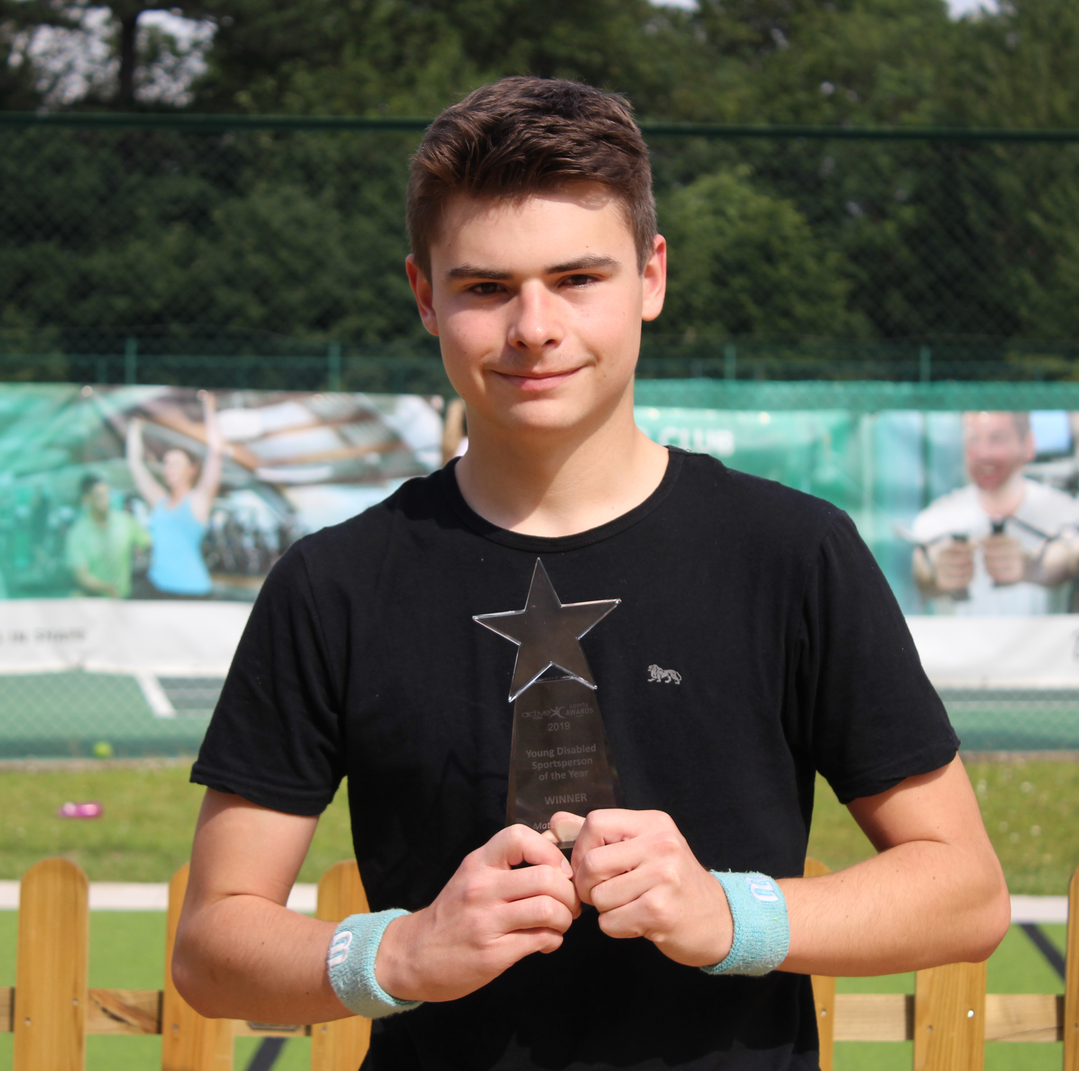 Matthew Brough with his Young Disabled Sportsperson of the Year trophy