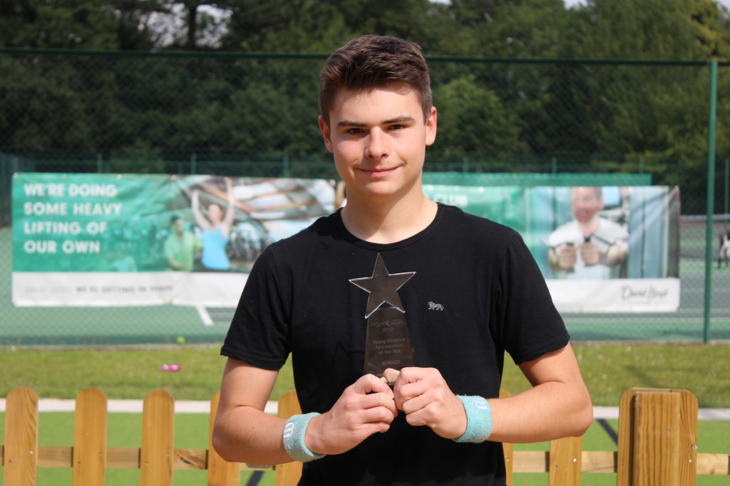 Matthew Brough with his Young Disabled Sportsperson of the Year Award